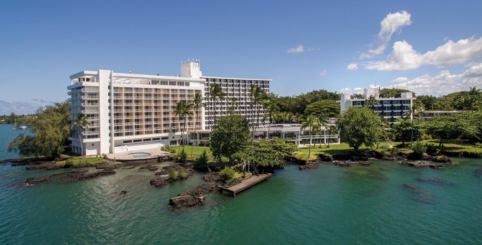Image of hotel exterior at Grand Naniloa Hotel Hilo, a DoubleTree by Hilton, 1939, Member of Historic Hotels of America, in Hilo, Hawaii, Special Offers, Discounted Rates, Families, Romantic Escape, Honeymoons, Anniversaries, Reunions