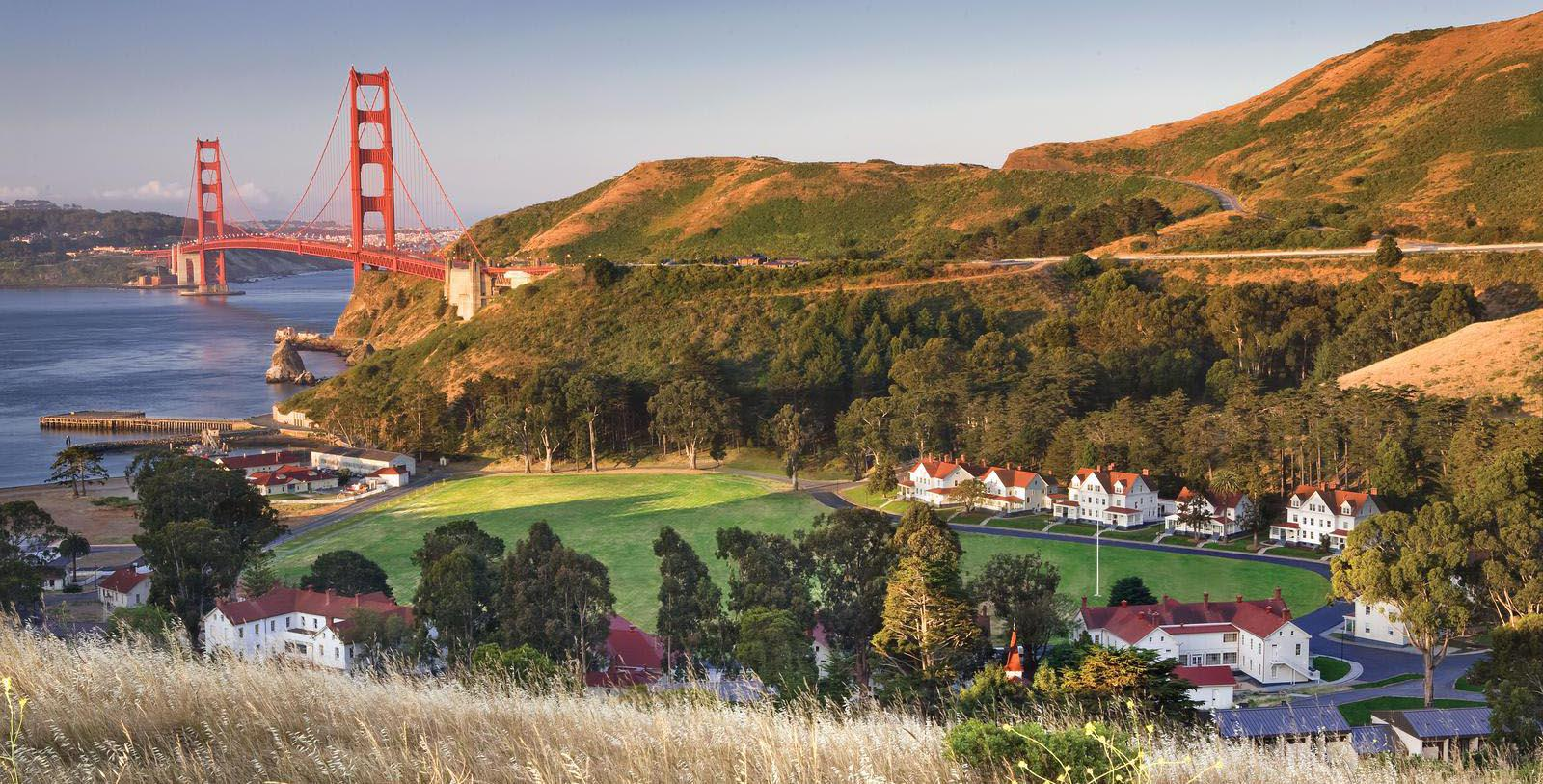Image of hotel exterior and golden gate bridge at Cavallo Point, 1901, Member of Historic Hotels of America, in San Francisco, California, Special Offers, Discounted Rates, Families, Romantic Escape, Honeymoons, Anniversaries, Reunions
