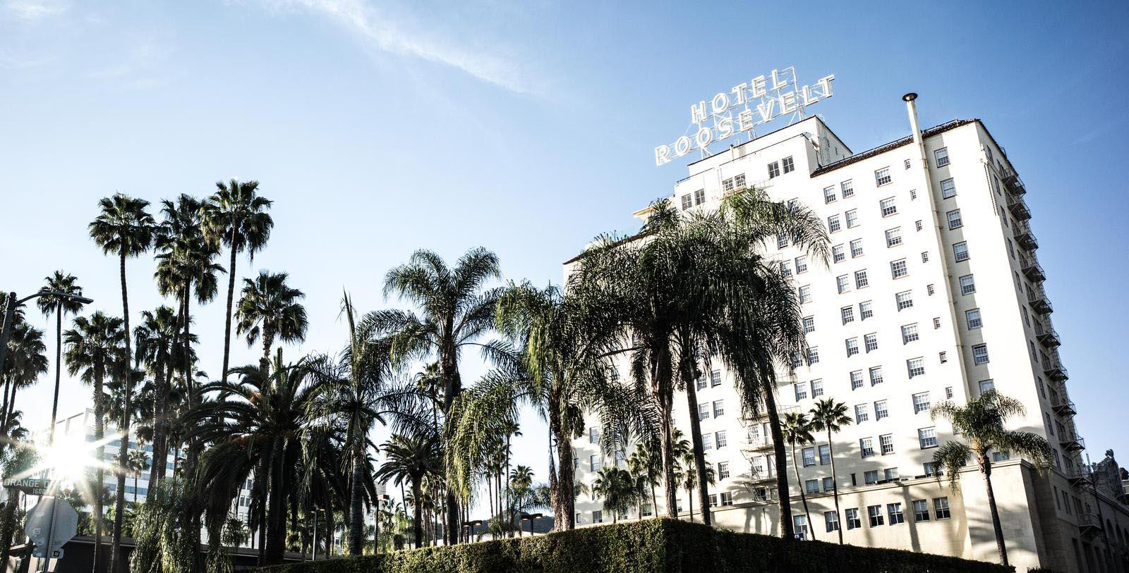 Image of Hotel Exterior with Palm Trees The Hollywood Roosevelt, 1927, Member of Historic Hotels of America, in Hollywood, California, Special Offers, Discounted Rates, Families, Romantic Escape, Honeymoons, Anniversaries, Reunions