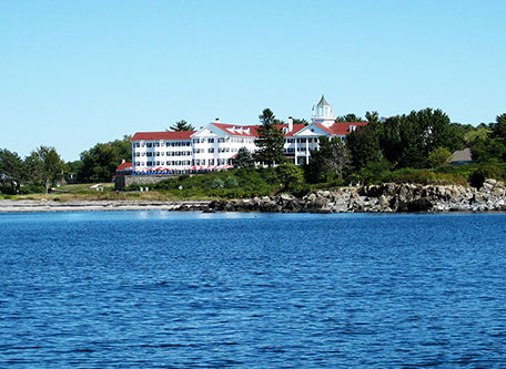 Image of Hotel Exterior with Beach The Colony Hotel, 1914, Member of Historic Hotels of America, in Kennebunkport, Maine, Special Offers, Discounted Rates, Families, Romantic Escape, Honeymoons, Anniversaries, Reunions