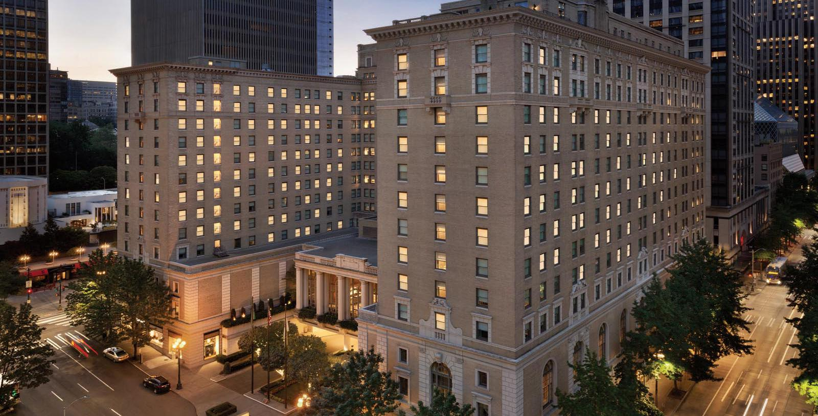 Image of hotel exterior at night Fairmont Olympic Hotel, 1924, Member of Historic Hotels of America, in Seattle, Washington, Special Offers, Discounted Rates, Families, Romantic Escape, Honeymoons, Anniversaries, Reunions