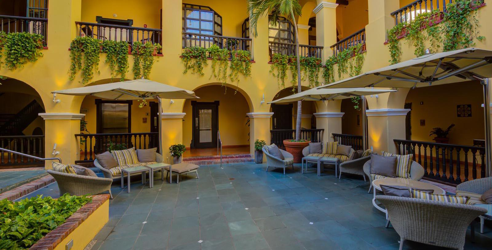 Image of hotel exterior courtyard at El Convento Hotel, 1948, Member of Historic Hotels of America, in San Juan, Puerto Rico, Special Offers, Discounted Rates, Families, Romantic Escape, Honeymoons, Anniversaries, Reunions