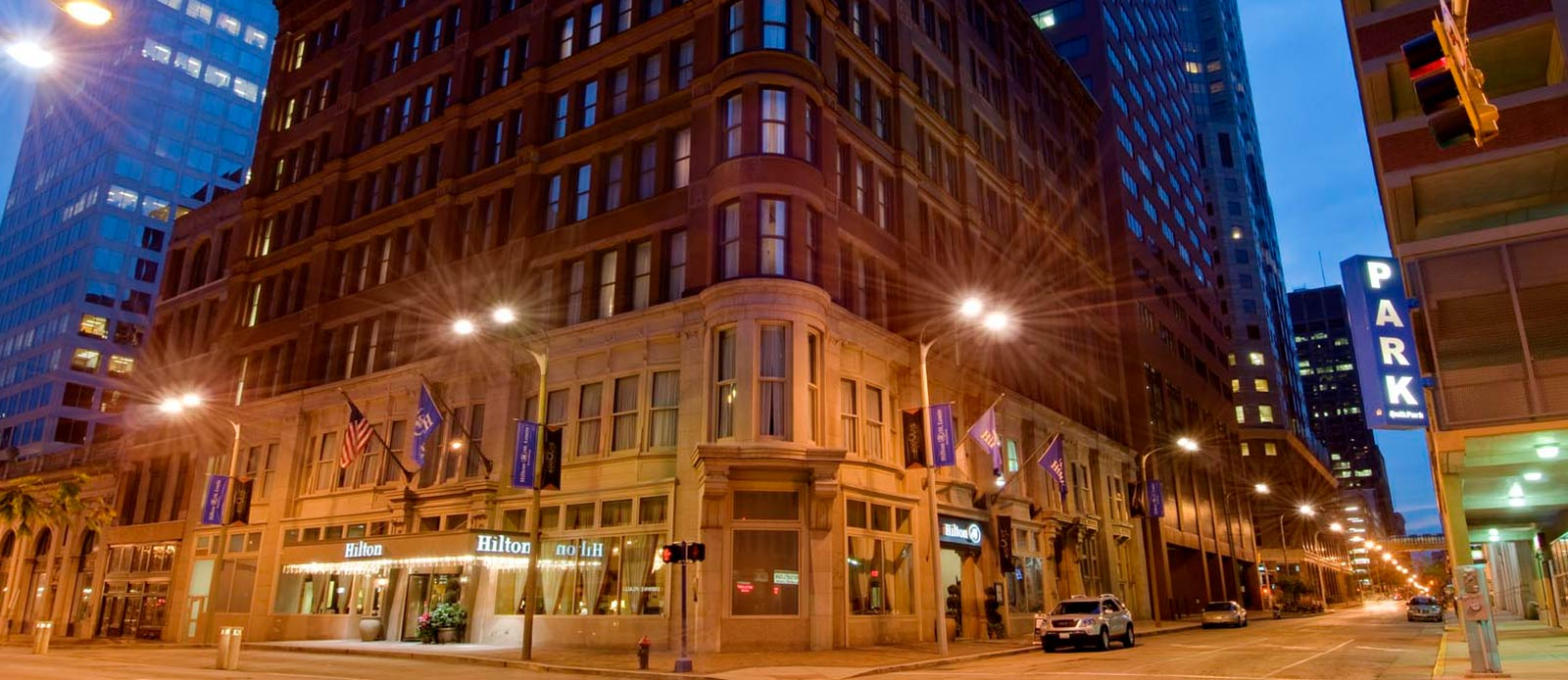 Image of Hotel Exterior at Night, Hilton St. Louis Downtown at the Arch in St. Louis, Missouri, 1888, Member of Historic Hotels of America, Special Offers, Discounted Rates, Families, Romantic Escape, Honeymoons, Anniversaries, Reunions