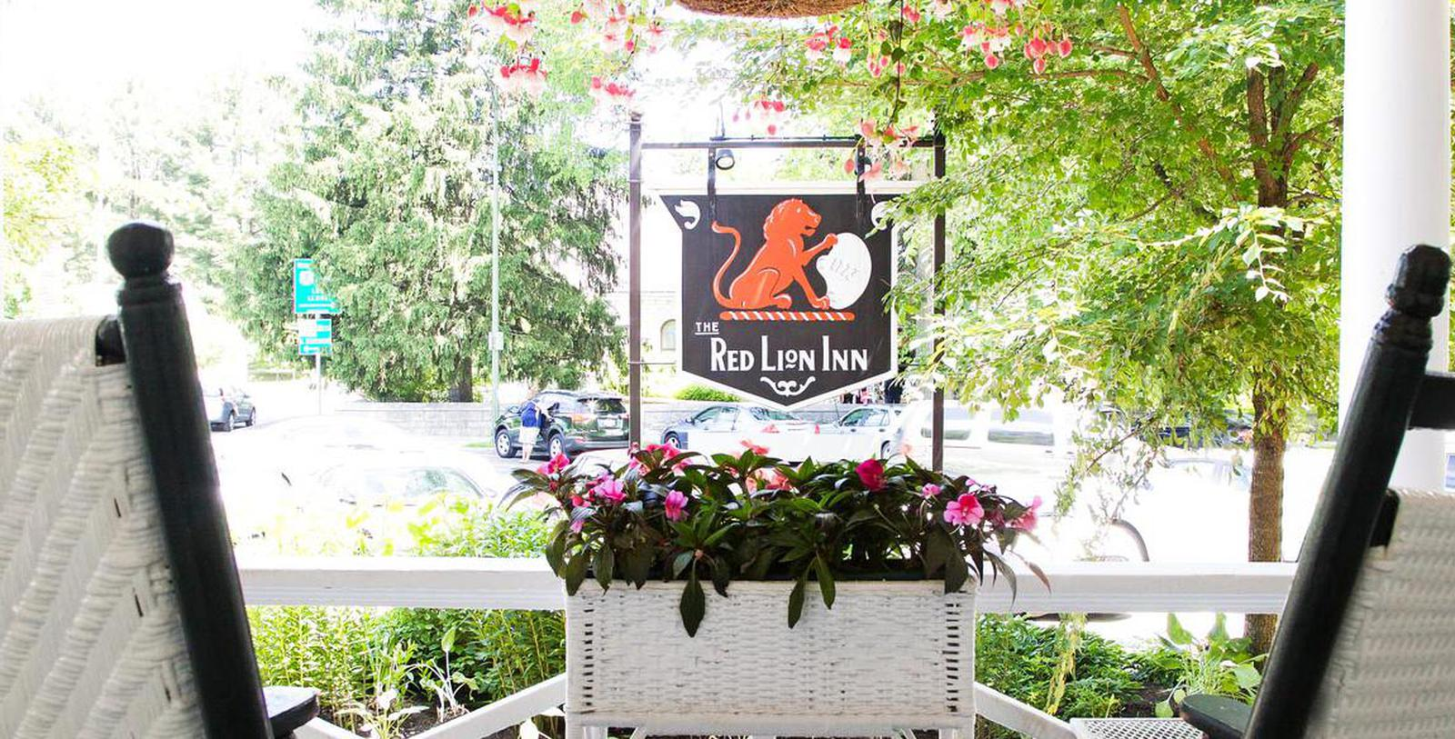 Image of Front Porch and Hotel Sign at The Red Lion Inn, 1773, Member of Historic Hotels of America, in Stockbridge, Massachusetts, Special Offers, Discounted Rates, Families, Romantic Escape, Honeymoons, Anniversaries, Reunions