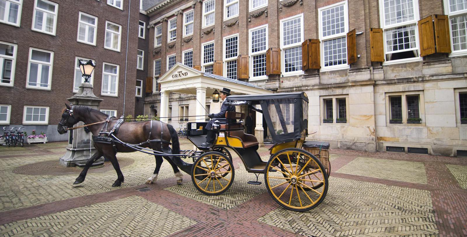 Image of Carriage Outside the Hotel Front Entrance at Sofitel Legend The Grand Amsterdam, 1578, Member of Historic Hotels Worldwide, in Amsterdam, Netherlands, Discover