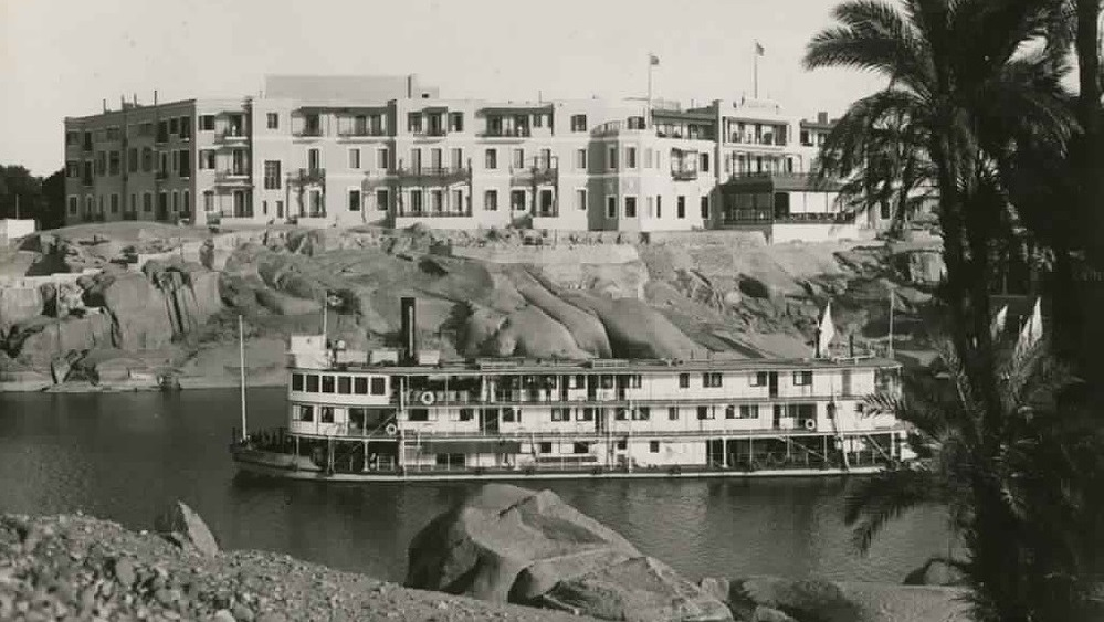 Historical Image of Exterior with Boat in Foreground, Sofitel Legend Old Cataract Aswan, 1899, Member of Historic Hotels Worldwide, in Aswan, Egypt