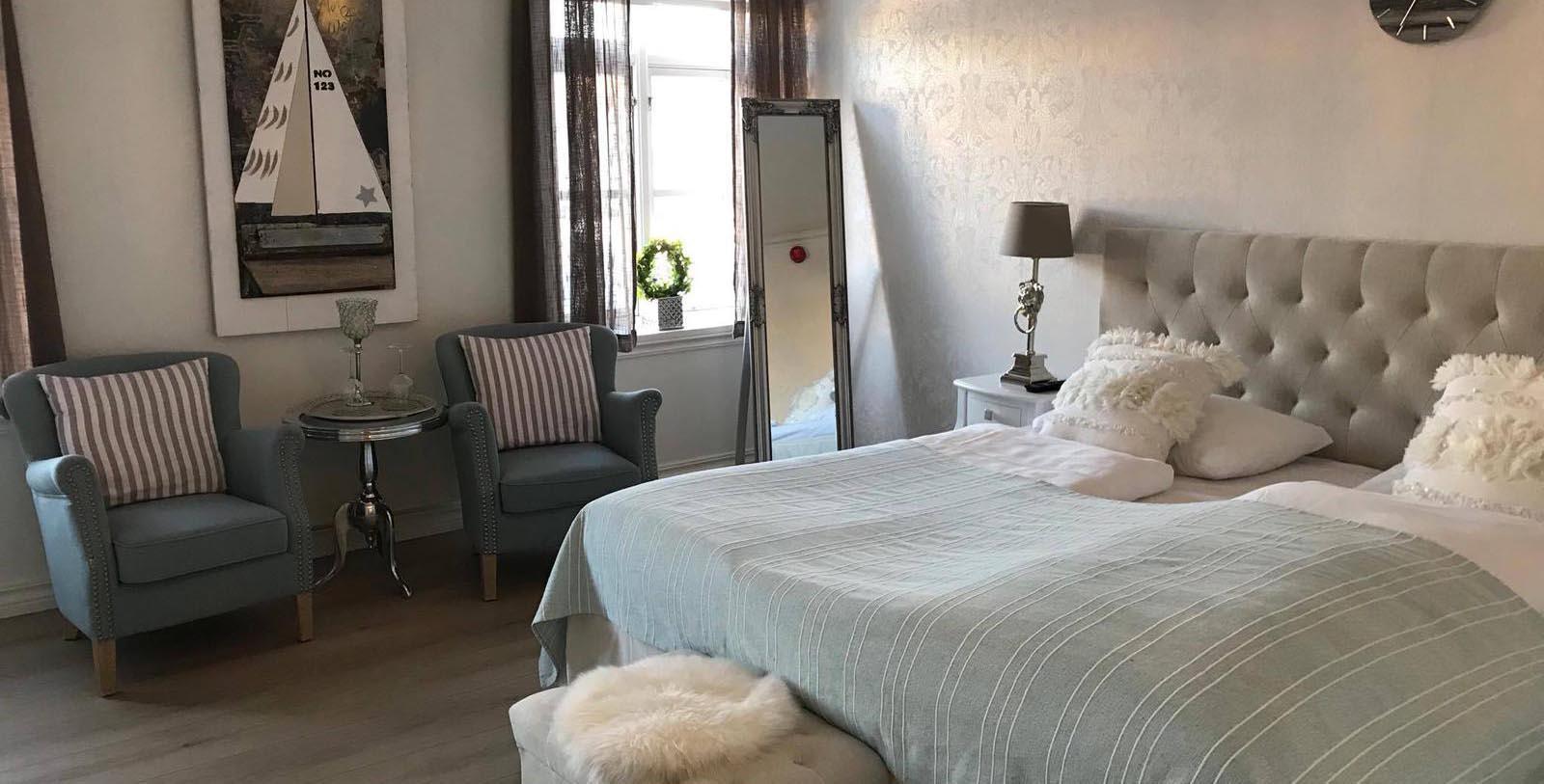 Image of guestroom Bekkjarvik Gjestgiveri, 1700s, Member of Historic Hotels Worldwide, in Norway, Explore