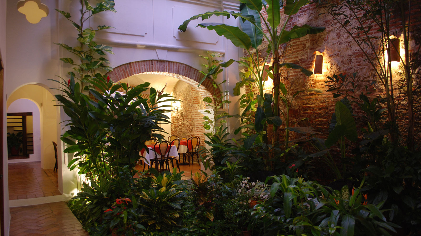 Image of garden patio restaurant at Alfiz Hotel, 1700, Member of Historic Hotels Worldwide, in Cartagena de Indias, Colombia, Taste