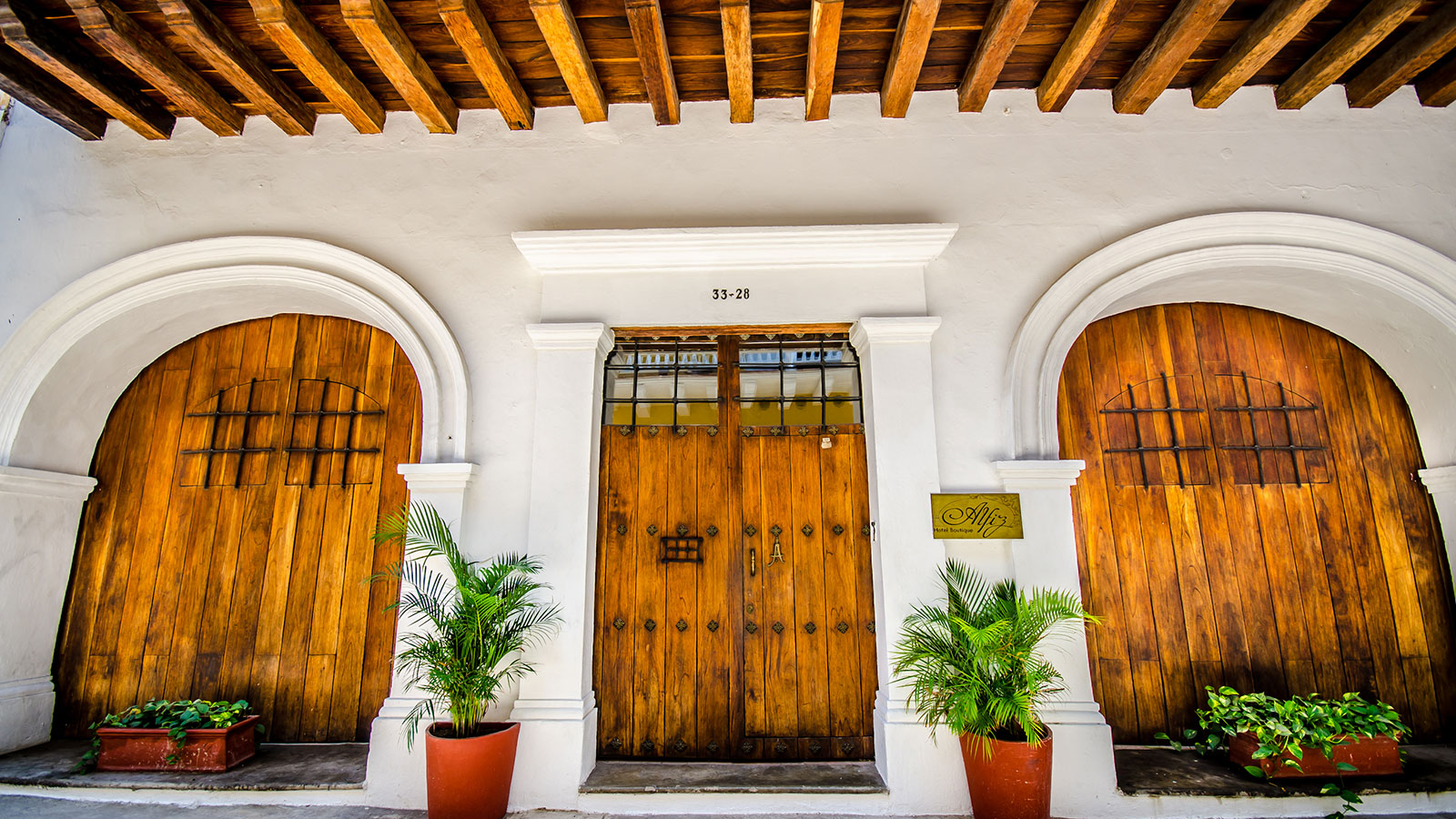 Image of gardn patio restaurant at Alfiz Hotel, 1700, Member of Historic Hotels Worldwide, in Cartagena de Indias, Colombia, Explore