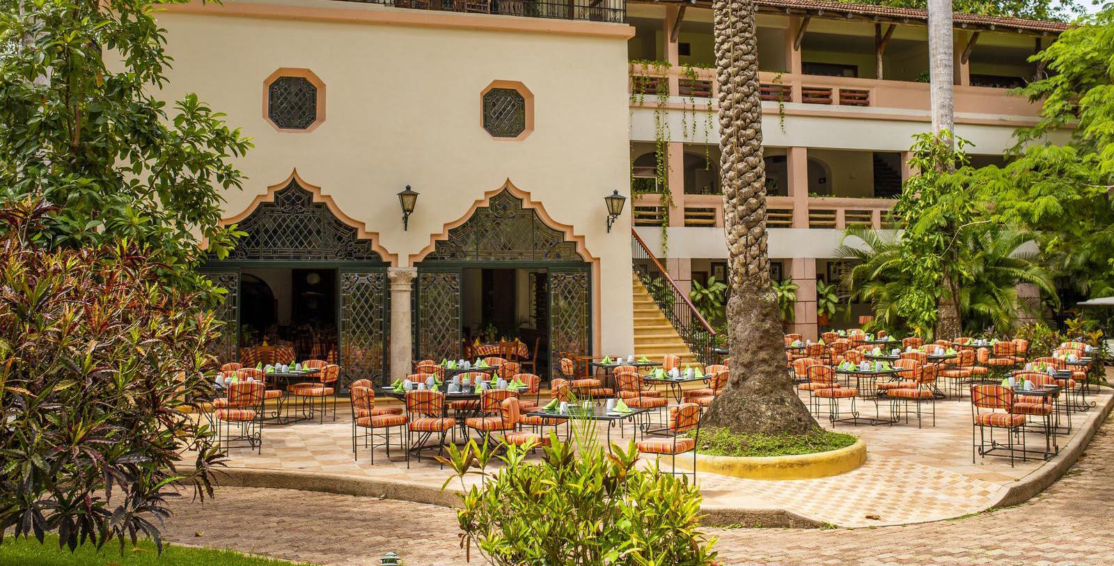 Image of Outdoor Dining Area with Palm Trees Mayaland Hotel & Bungalows,1923, Member of Historic Hotels Worldwide, in Chichen Itza, Mexico, Experience