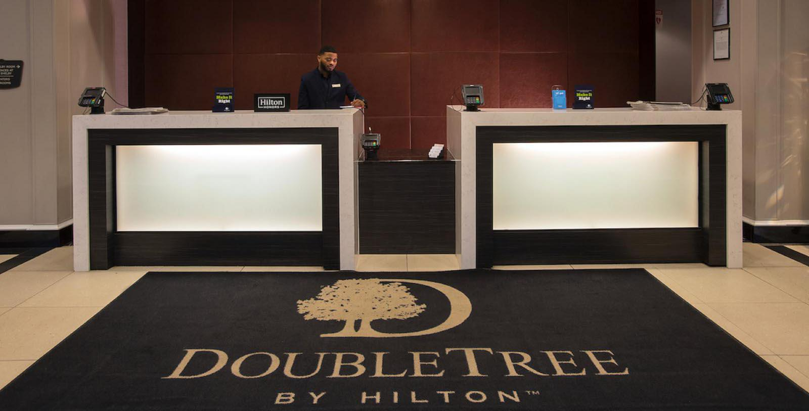 Image of Front desk in hotel lobby at DoubleTree Suites by Hilton Hotel Detroit Downtown - Fort Shelby, 1917, Member of Historic Hotels of America, in Detroit, Michigan, Special Offers, Discounted Rates, Families, Romantic Escape, Honeymoons, Anniversaries, Reunions