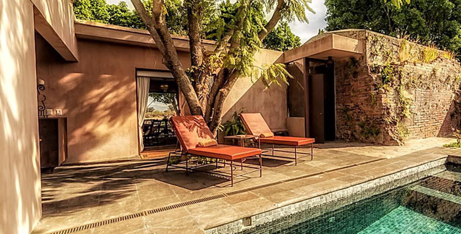 Image of Guestroom Exterior & Lounge Chairs by Pool, Hacienda el Carmen Hotel & Spa, Ahualulco de Mercado, 1722, Member of Historic Hotels Worldwide, Hot Deals