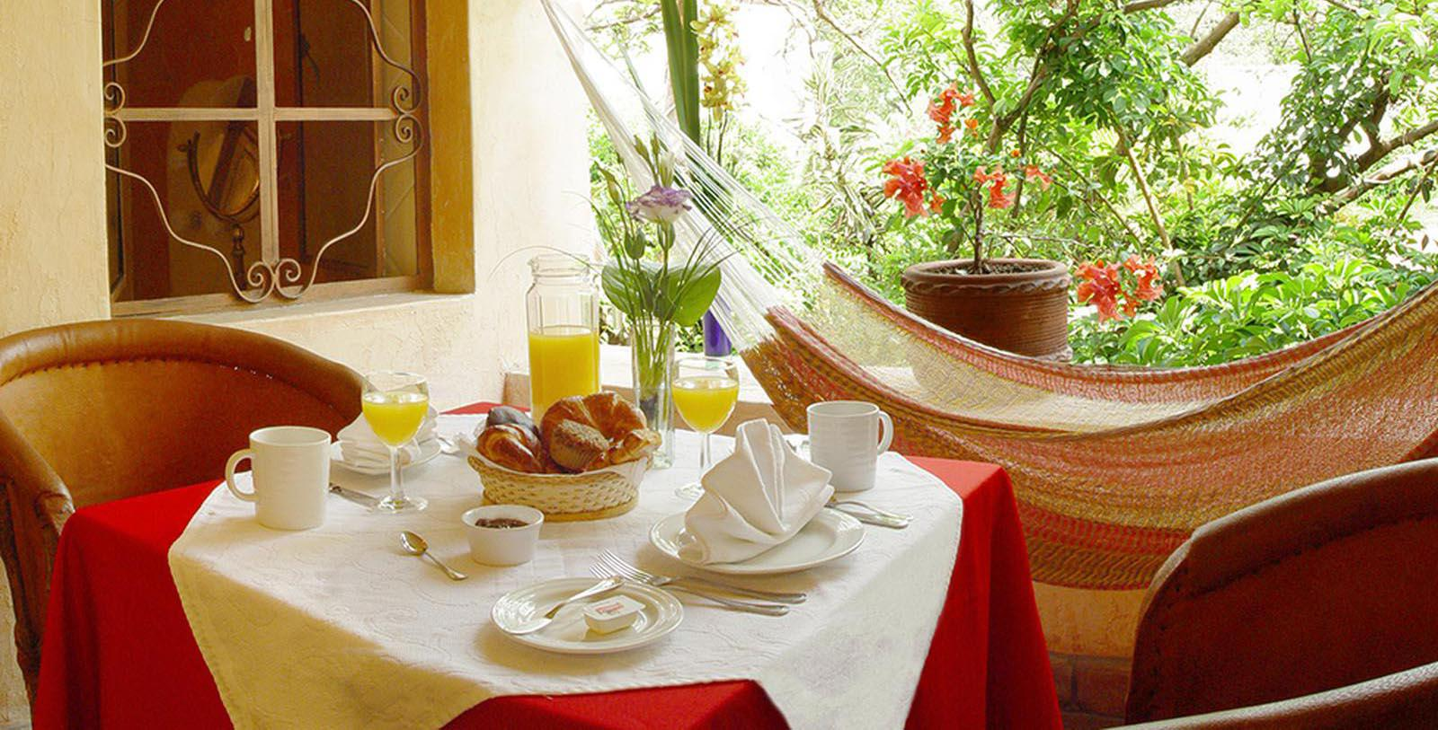 Image of Breakfast Served on Terrace Dining Table at Villa Ganz Boutique Hotel, 1930, Member of Historic Hotels Worldwide, in Guadalajara, Jalisco, Mexico, Taste