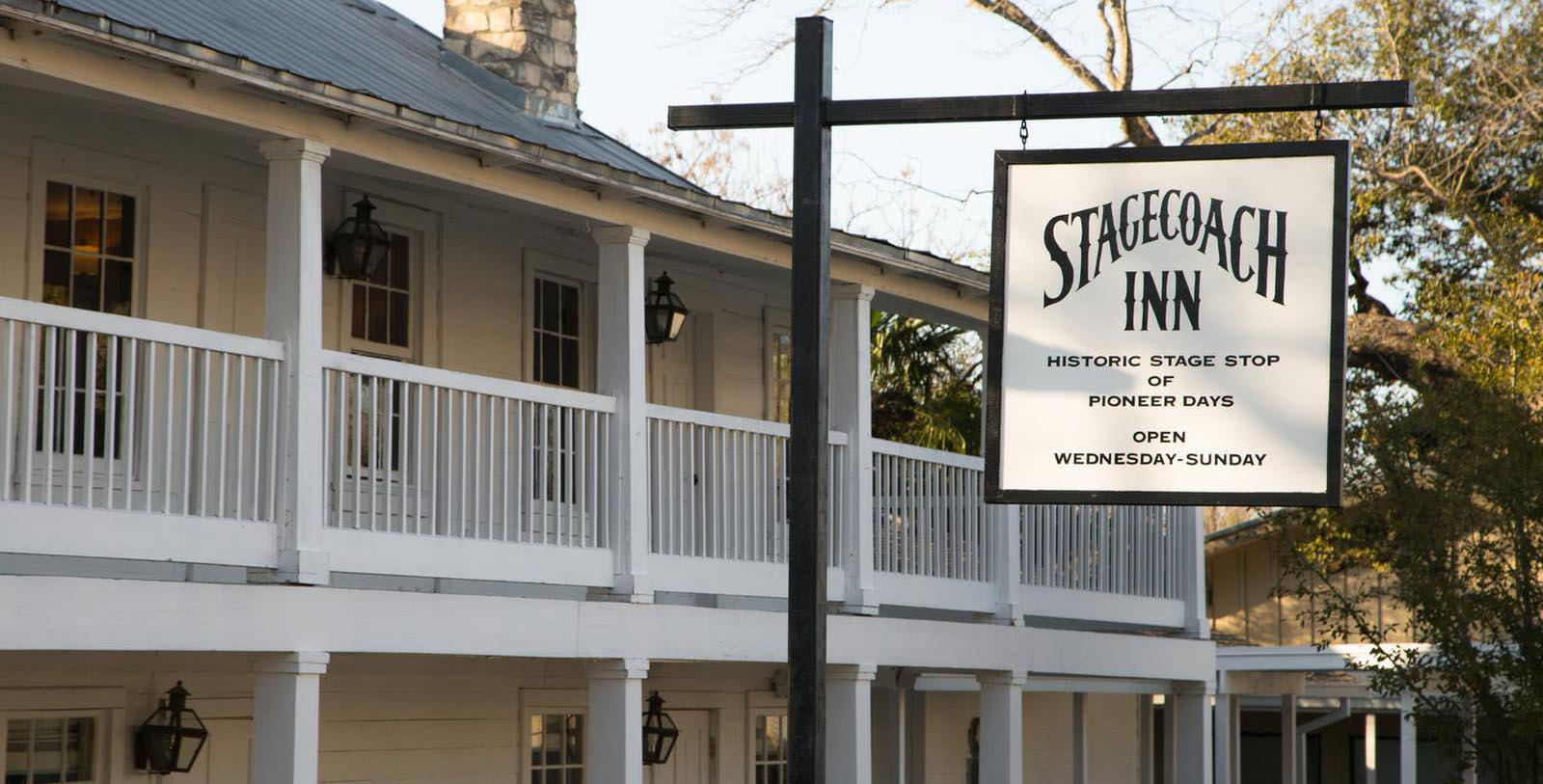 Image of Hotel Front Entrance and Hotel Sign at The Stagecoach Inn, 1852, Member of Historic Hotels of America, in Salado, Texas, Special Offers, Discounted Rates, Families, Romantic Escape, Honeymoons, Anniversaries, Reunions