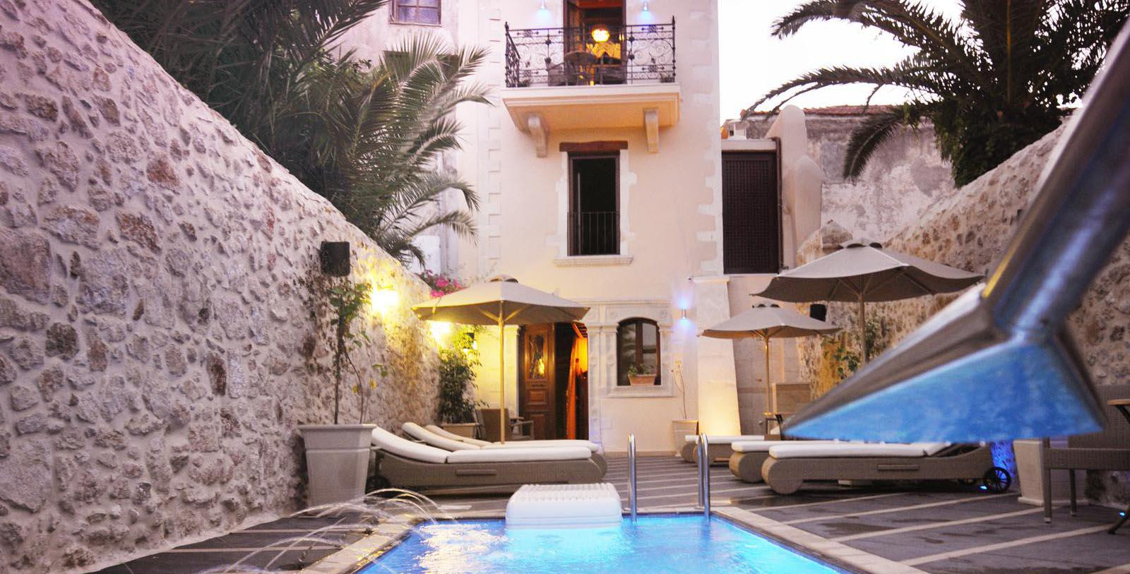 Image of hotel exterior and pool Antica Dimora Suites, 1820, Member of Historic Hotels Worldwide, in Crete, Greece, Special Offers, Discounted Rates, Families, Romantic Escape, Honeymoons, Anniversaries, Reunions