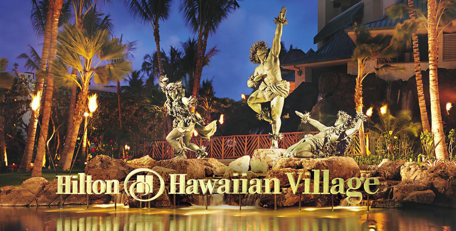 Image of statues at night Hilton Hawaiian Village® Waikiki Beach Resort, 1957, Member of Historic Hotels of America, in Honolulu, Hawaii, Discover