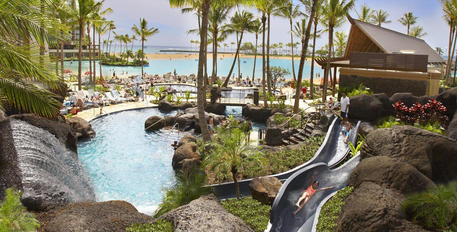 Image of pool and palm treesHilton Hawaiian Village® Waikiki Beach Resort, 1957, Member of Historic Hotels of America, in Honolulu, Hawaii, Explore