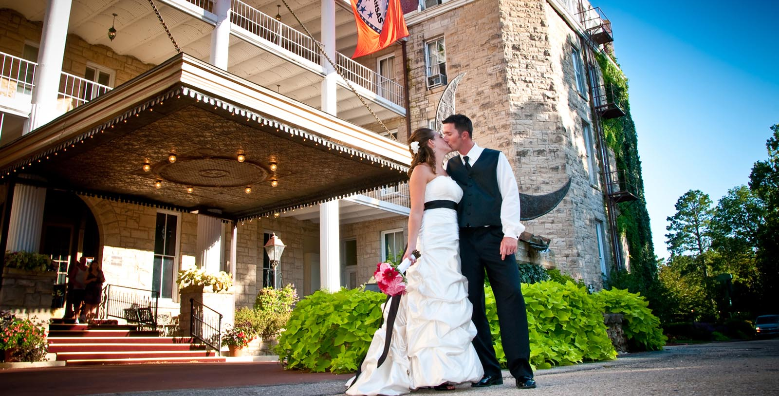 Image of Wedding Couple Outside 1886 Crescent Hotel & Spa, Member of Historic Hotels of America, in Eureka Springs, Arkansas, Special Occasions