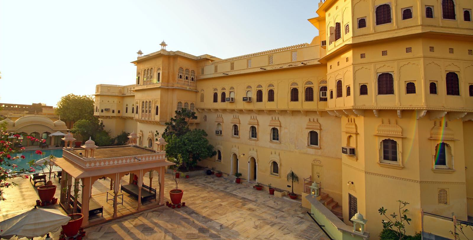 Image of hotel exterior courtyard with pool Alsisar Mahal, 1800s, Member of Historic Hotels Worldwide, in Jhunjhunu, India, Hot Deals