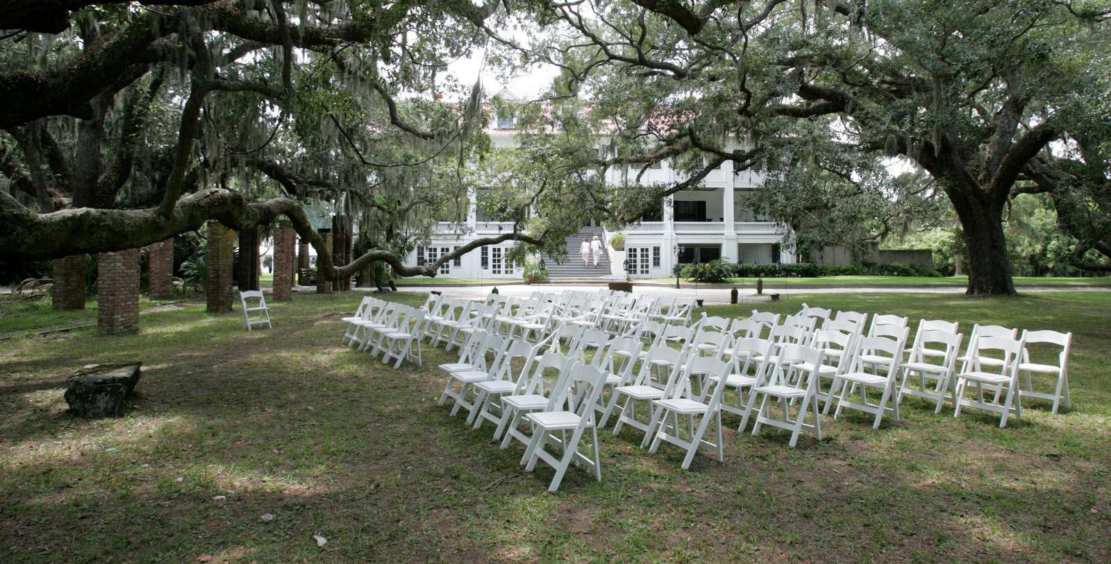 Image of chairs set up for outdoor wedding ceremony Greyfield Inn, 1900, Member of Historic Hotels of America, in Cumberland Island, Georgia, Experience