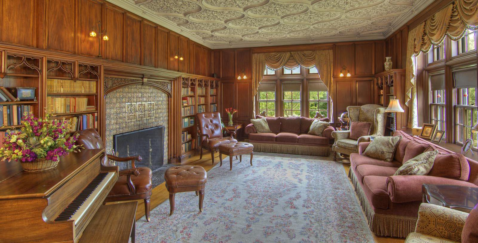 Image of lounge area with fireplace at Castle Hill Resort and Spa, 1905, Member of Historic Hotels of America, in Cavendish, Vermont, Discover