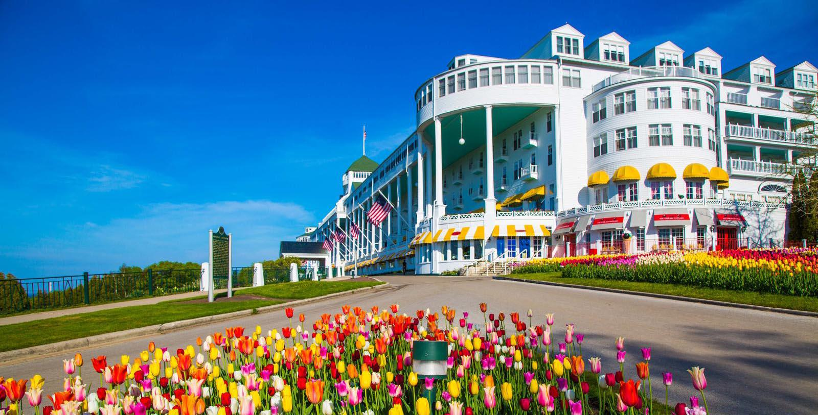 Image of hotel exterior at Grand Hotel, 1887, Member of Historic Hotels of America, in Mackinac Island, Michigan, Special Offers, Discounted Rates, Families, Romantic Escape, Honeymoons, Anniversaries, Reunions