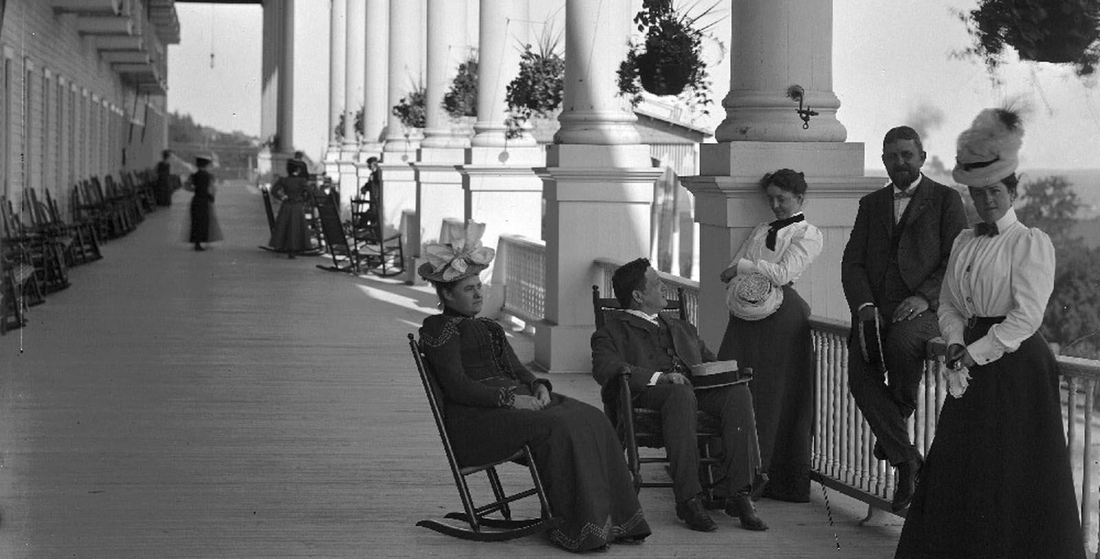 Historic images of people standing on porch at Grand Hotel, 1887, Member of Historic Hotels of America, in Mackinac Island, Michigan, Discover
