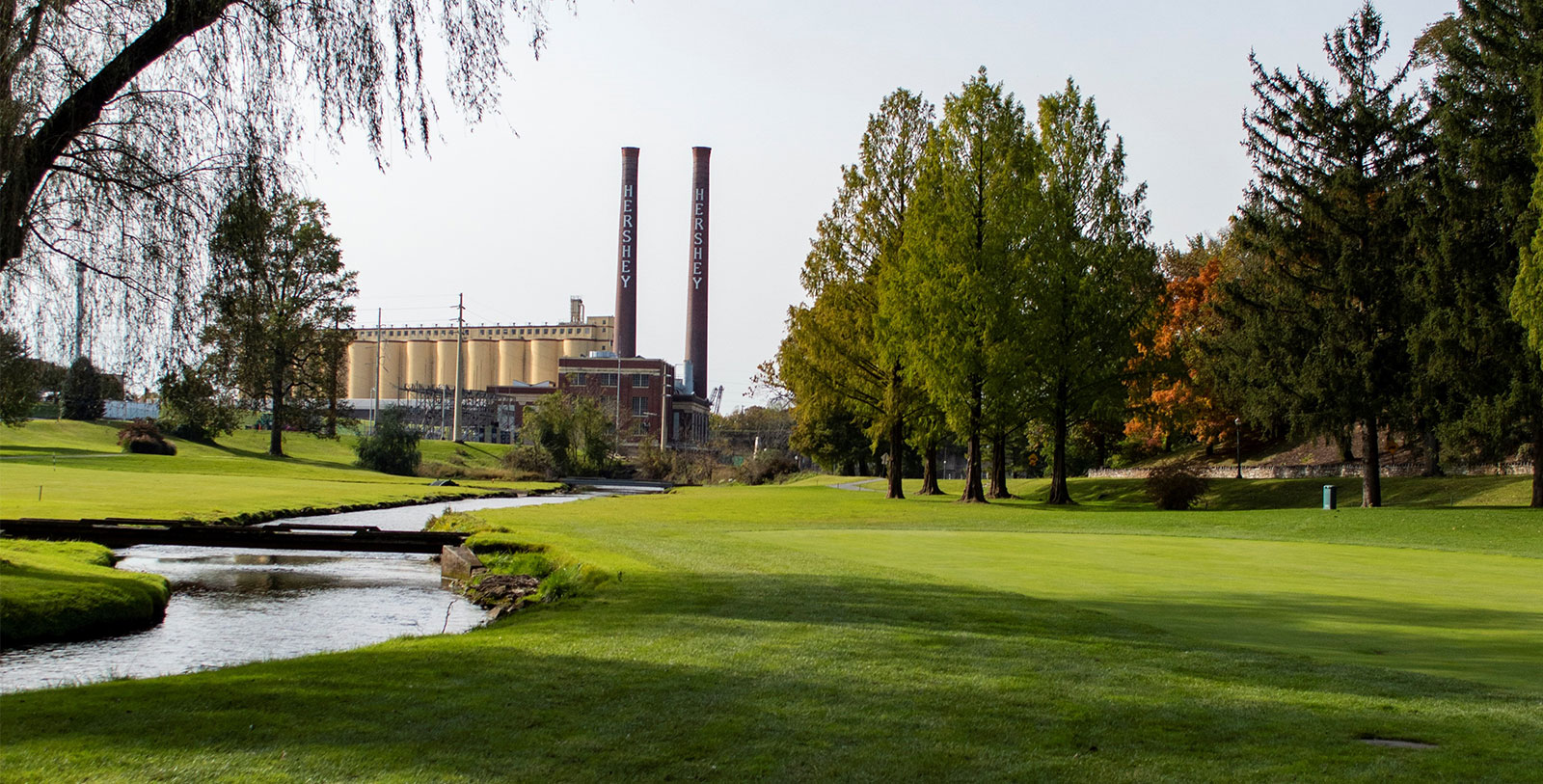 Image of Hotel Hershey's Golf Course with Chocolate Factory in the background, 1933, Member of Historic Hotels of America, Hershey, Pennsylvania, Golf
