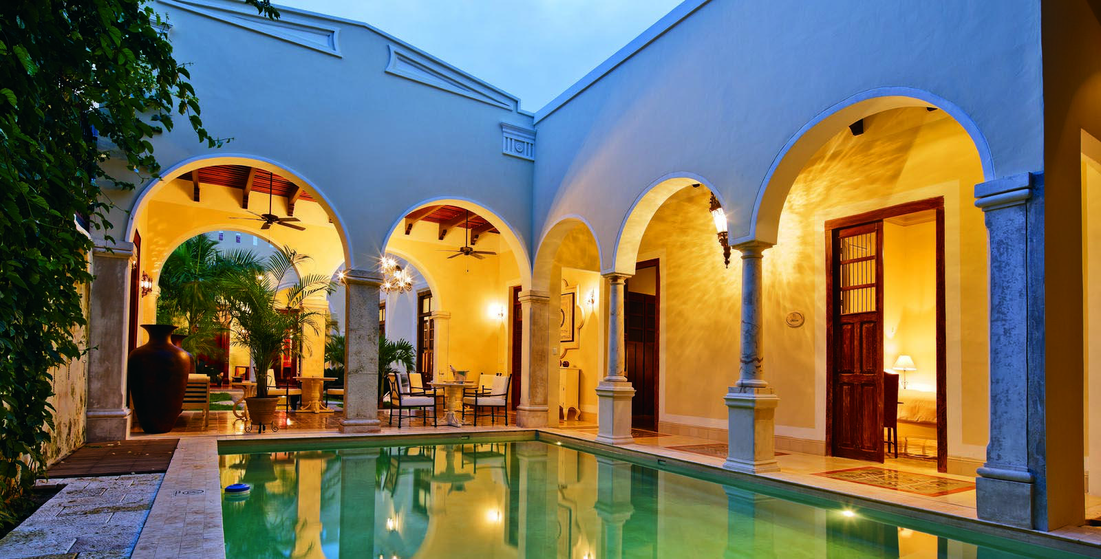 Image of outdoor pool area at night Casa Lecanda, 1900s, Member of Historic Hotels Worldwide, in Merida, Mexico, Hot Deals