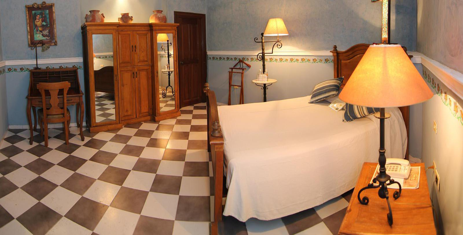 Image of Guestroom Interior La Misión de Fray Diego, 1867 Member of Historic Hotels Worldwide, in Merida, Mexico, Location