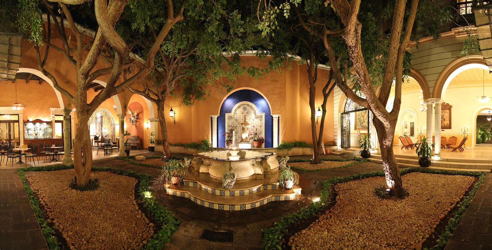 Image of Fountain and Outdoor Seating La Misión de Fray Diego, 1867, Member of Historic Hotels Worldwide, in Merida, Mexico, Special Offers, Discounted Rates, Families, Romantic Escape, Honeymoons, Anniversaries, Reunions