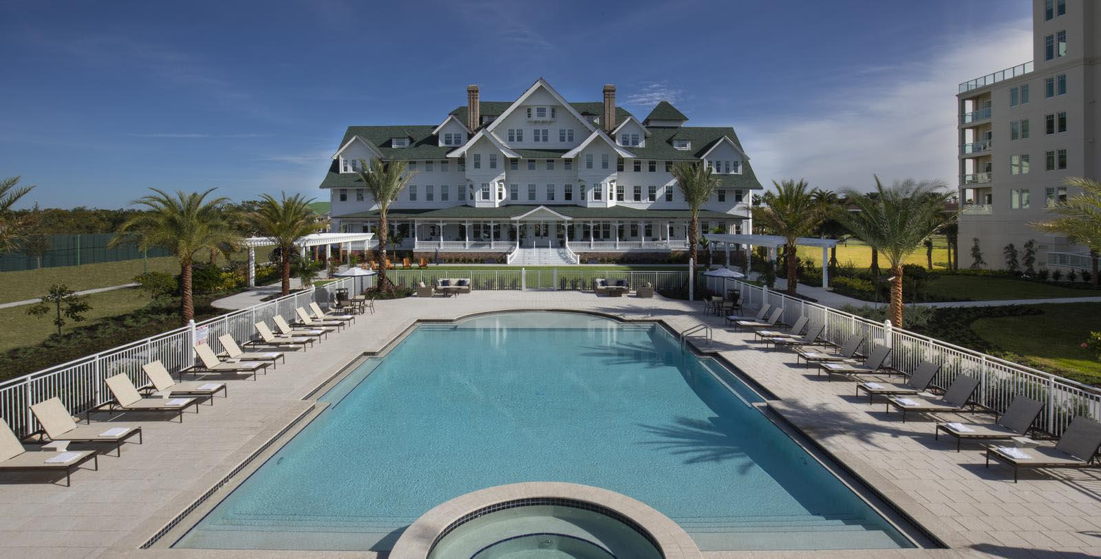 Image of Pool and hotel exterior at Belleview Inn, 1897, Member of Historic Hotels of America, in Belleair, Florida, Hot Deals