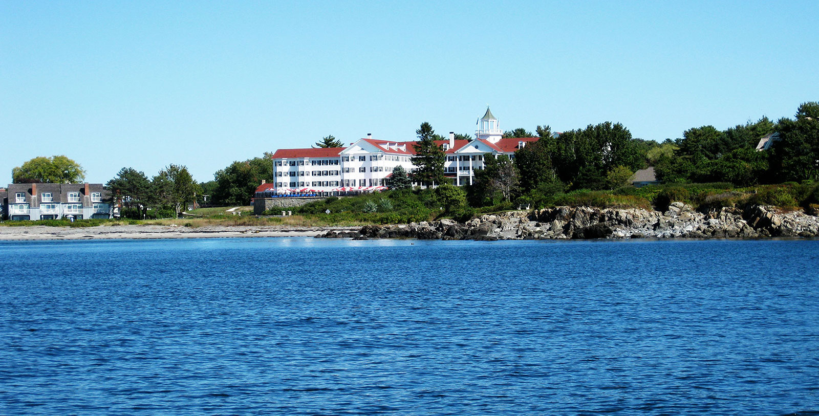 Image of Hotel Exterior with Beach The Colony Hotel, 1914, Member of Historic Hotels of America, in Kennebunkport, Maine, Overview