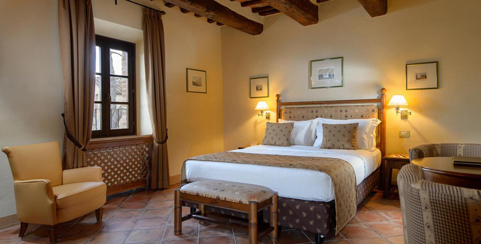 Image of Guestroom Interior La Bagnaia Golf & Spa Resort Siena, Curio Collection by Hilton, 11th Century, Member of Historic Hotels Worldwide, in Siena, Italy, Location