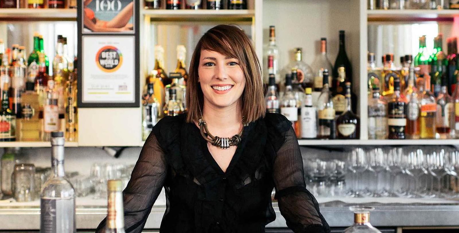 Image of bartender standing in front of Proof bar at 21c Museum Hotel Louisville by MGallery, 1800, Member of Historic Hotels of America, in Louisville, Kentucky, Taste