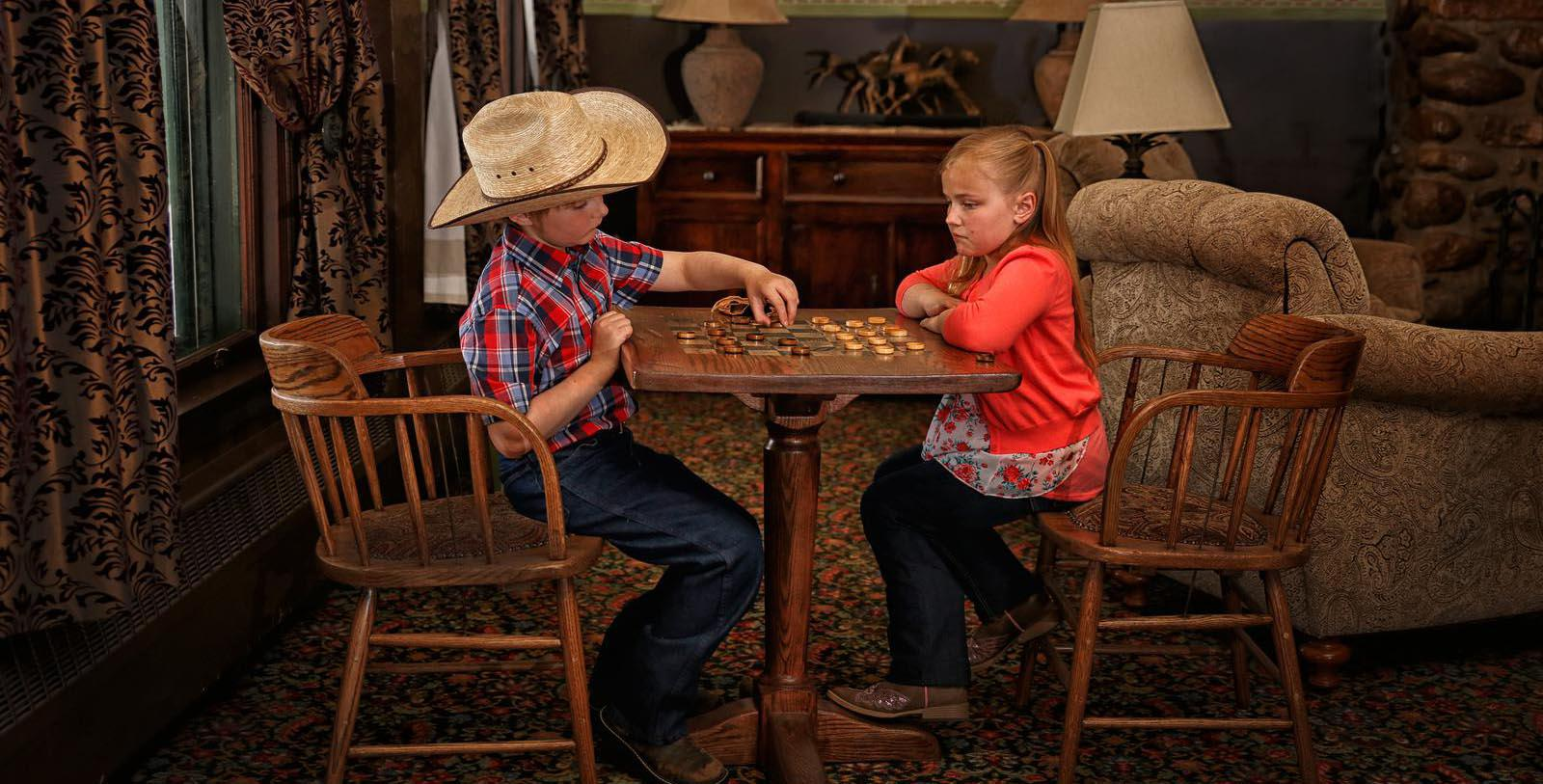 Image of Children Playing Checkers in Seating Area Sheridan Inn, 1893, Member of Historic Hotels of America, in Sheridan, Wyoming, Explore
