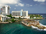 Book a stay at Caribe Hilton