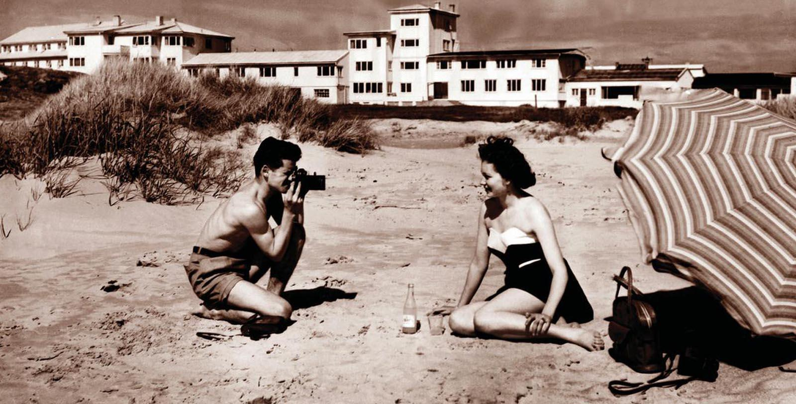 Historic Image of Two Guests on Beach at Sola Strand Hotel, 1914, Member of Historic Hotels Worldwide, in Sola, Norway, Discover