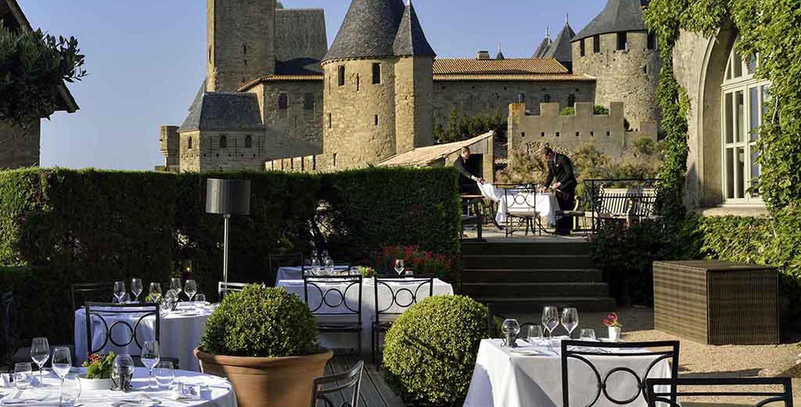 Image of Outdoor Dining Area Hôtel de la Cité Carcassonne - MGallery by Sofitel, 1909, Member of Historic Hotels Worldwide, in Carcassonne, France, Experience