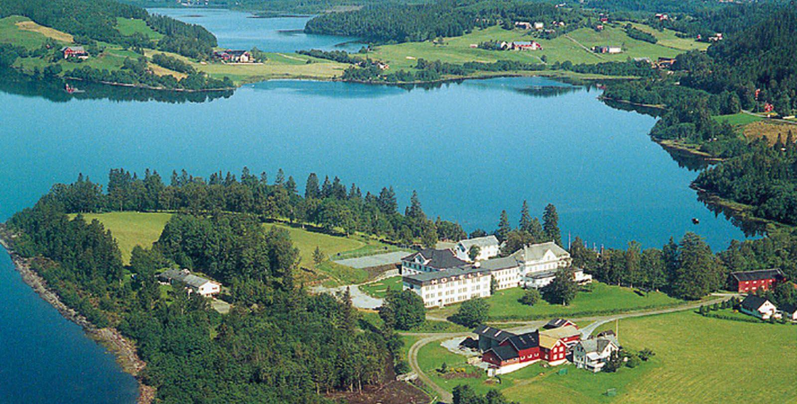 Image of Hotel Exterior and Lake at Selbusjoen Hotel & Gjestegard, 1850, Member of Historic Hotels Worldwide, in Selbu, Norway, Discover