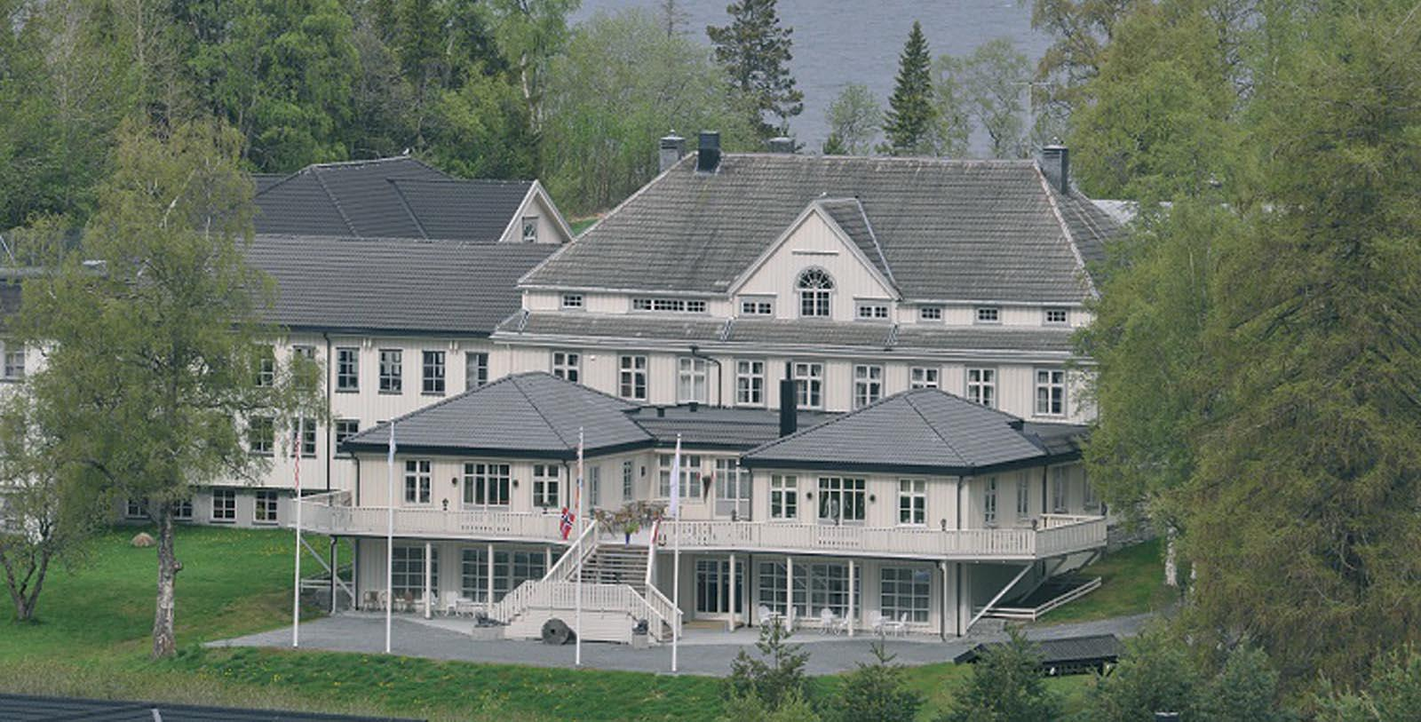Image of Hotel Exterior and Lake at Selbusjoen Hotel & Gjestegard, 1850, Member of Historic Hotels Worldwide, in Selbu, Norway, Explore