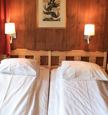 Accommodations:      Fossheim Turisthotell  in Lom