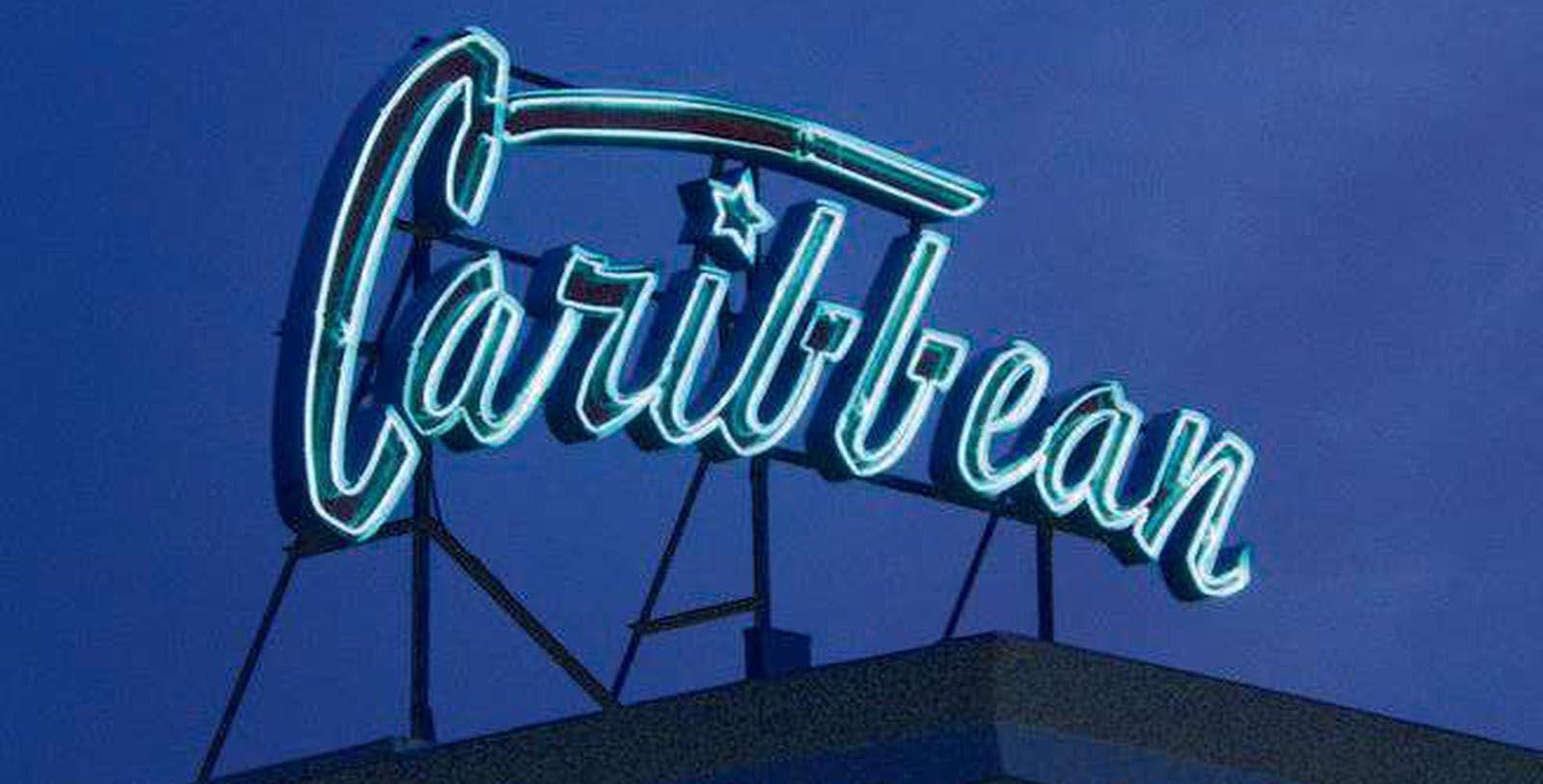 Image of Hotel sign at Caribbean Motel, 1957, Member of Historic Hotels of America, in Wildwood Crest, New Jersey, Experience