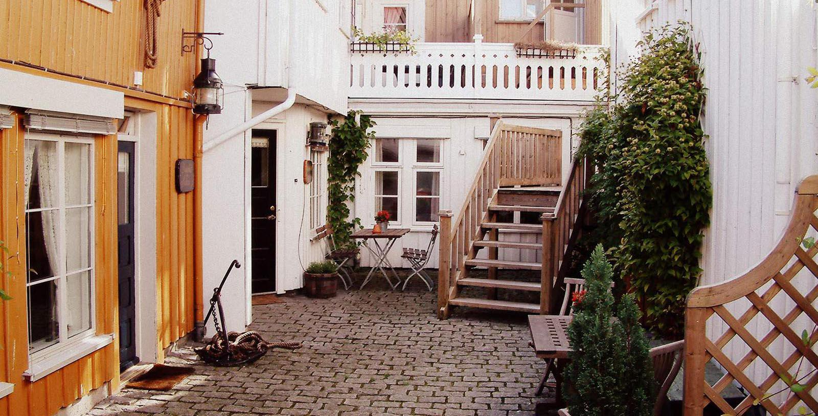 Image of courtyard area outside Det Lille Hotel, 1750, Member of Historic Hotels Worldwide, Risør, Norway, Special Offers, Discounted Rates, Families, Romantic Escape, Honeymoons, Anniversaries, Reunions