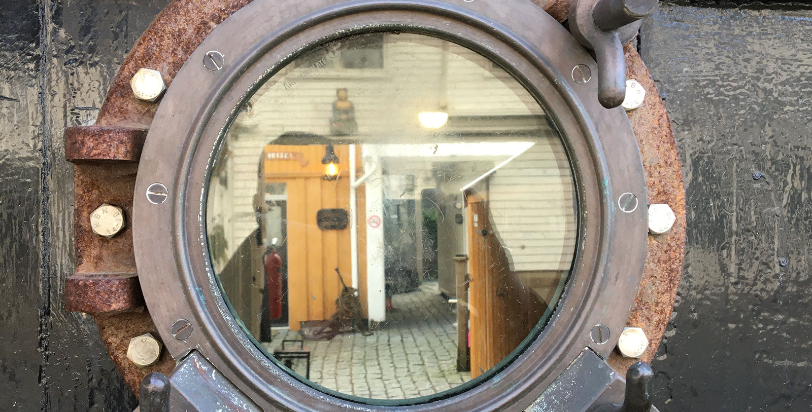 Image of Port Hole, Det Lille Hotel, 1750, Member of Historic Hotels Worldwide, Risør, Norway, Experience