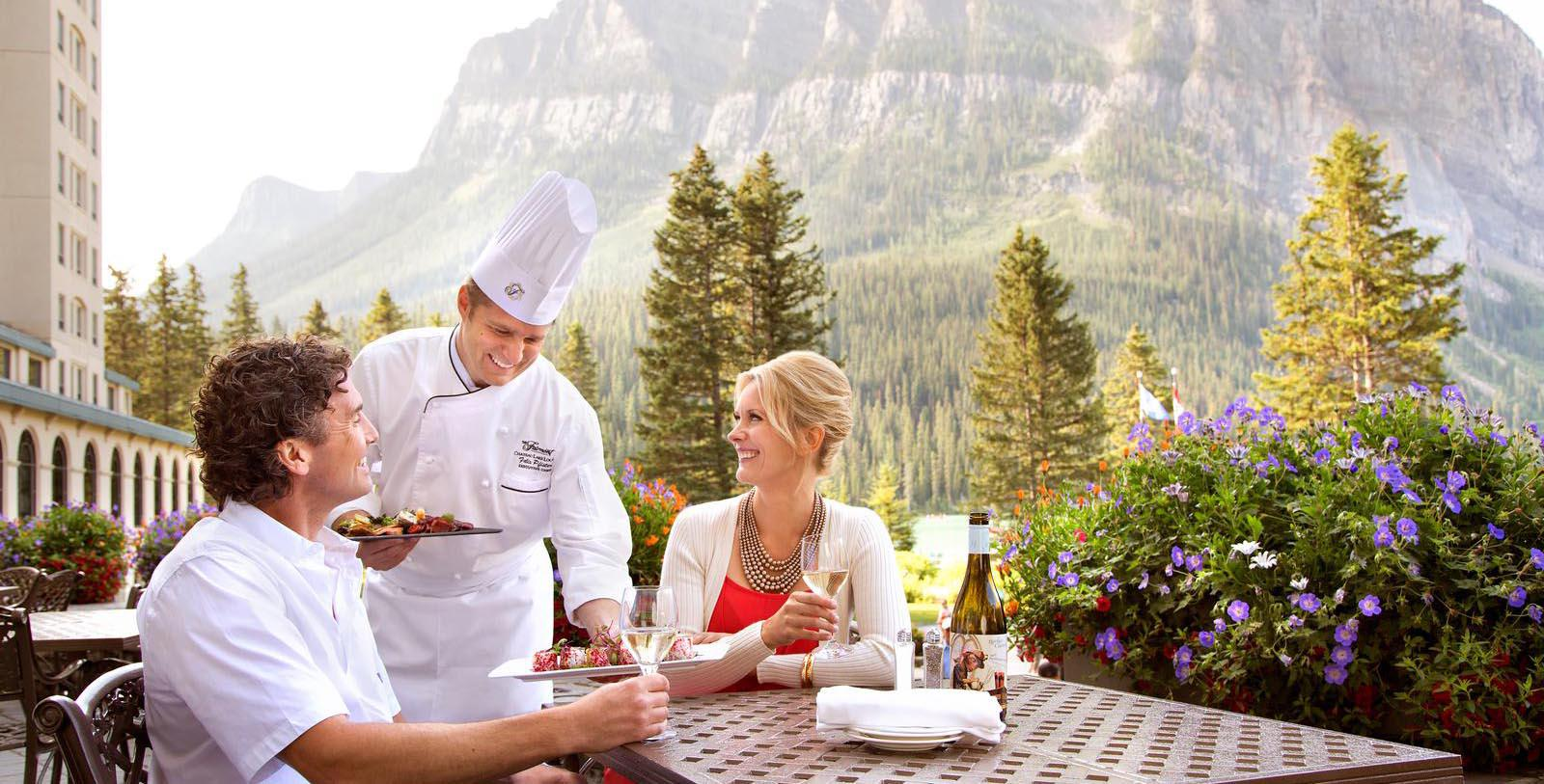Image of guests dining outside at Fairmont Chateau Lake Louise, 1911, Member of Historic Hotels Worldwide, in Lake Louise, Alberta, Canada, Taste