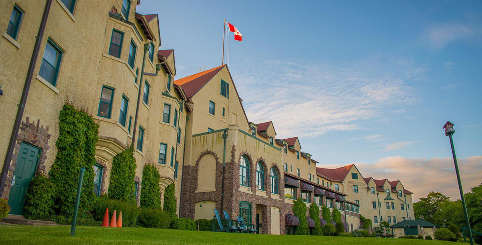 Image of hotel exterior Digby Pines Golf Resort and Spa, 1905, Member of Historic Hotels Worldwide, in Digby, Nova Scotia, Canada, Special Offers, Discounted Rates, Families, Romantic Escape, Honeymoons, Anniversaries, Reunions