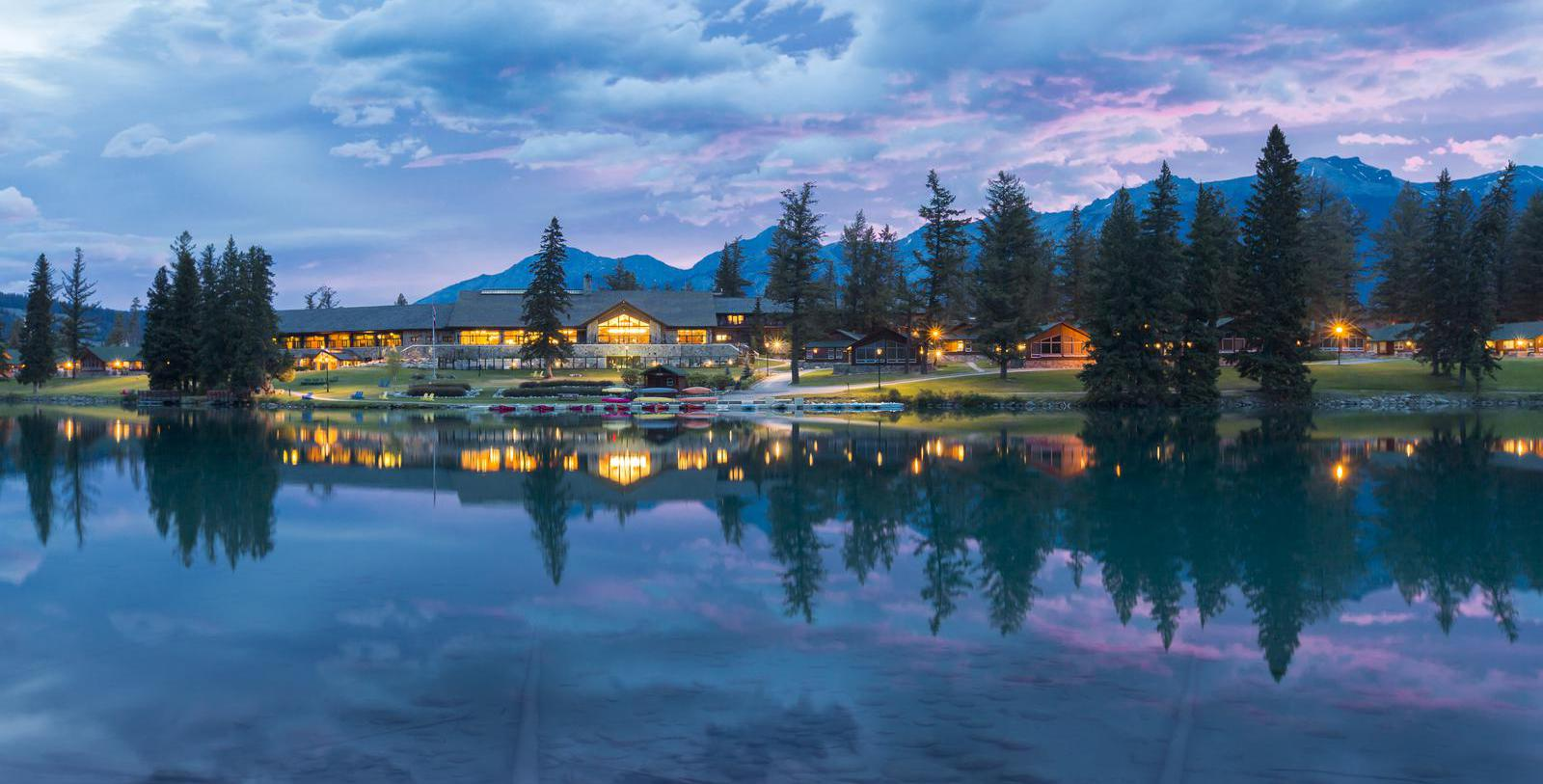 Image of hotel exterior and lake Fairmont Jasper Park Lodge, 1922, Member of Historic Hotels Worldwide, in Jasper, Alberta, Canada, Special Offers, Discounted Rates, Families, Romantic Escape, Honeymoons, Anniversaries, Reunions