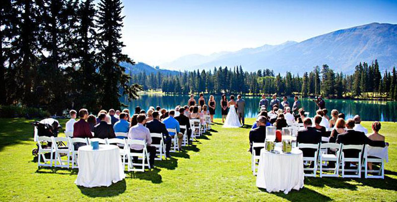 Image of outdoor wedding on the grounds at Fairmont Jasper Park Lodge, 1922, Member of Historic Hotels Worldwide, in Jasper, Alberta, Canada, Experience