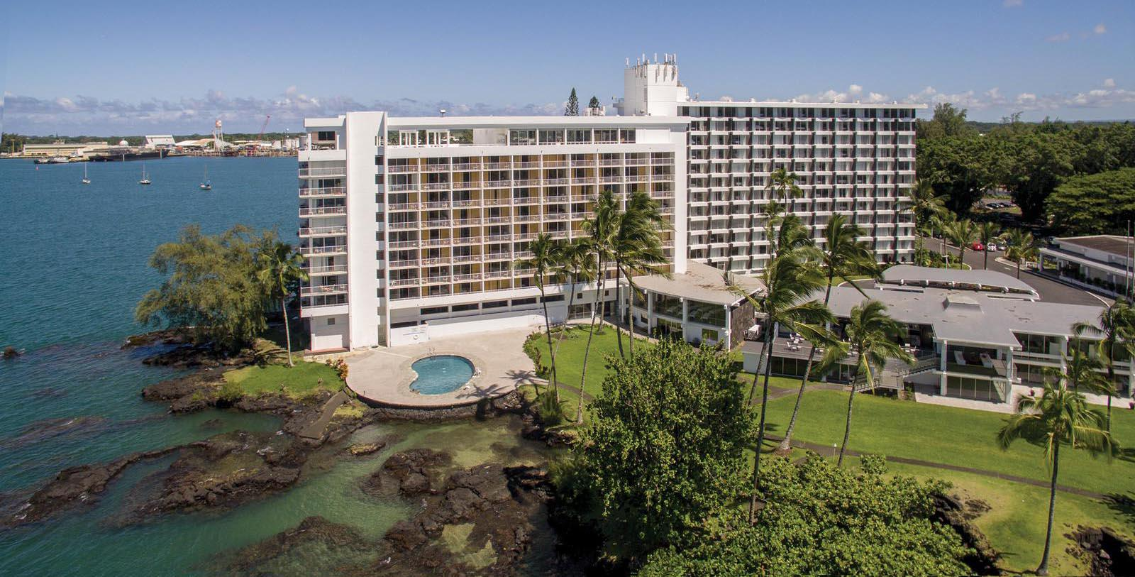 Exterior daytime aerial view of the Grand Naniloa Hotel Hilo, a DoubleTree by Hilton in Hawaii.